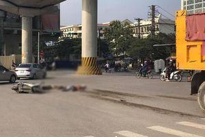 Hà Nội: Ô tô tải cuốn xe máy vào gầm, cán hai ông cháu tử vong