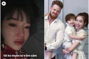 Elly Trần nằm khóc trong bóng tối, ẩn ý chồng ngoại tình