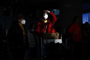 WHO họp khẩn khi Trung Quốc nói rằng virus conona có thể lây từ người sang người
