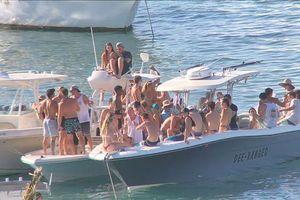 Phớt lờ cảnh báo của chính quyền, người dân Mỹ vẫn ăn chơi và tắm biển