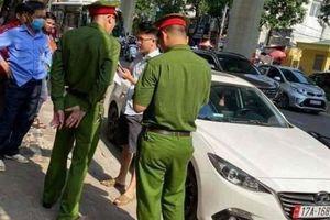 Hà Nội: Bắt tạm giam tài xế hất chiến sỹ công an lên nắp capo