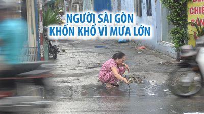 Người Sài Gòn khốn khổ trong buổi sáng trời âm u, mưa tầm tã