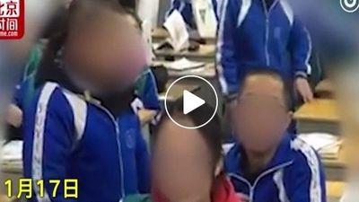 Giáo viên cạo đầu 4 học sinh ngay trên lớp vì đi học muộn