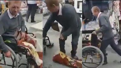 Gã ăn mày ngồi xe lăn xin tiền bị lật tẩy