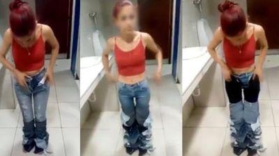 Clip chủ cửa hàng bắt gái xinh cởi 8 quần jeans ăn trộm khỏi người